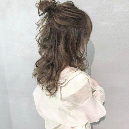 Half-up bun semi long hair