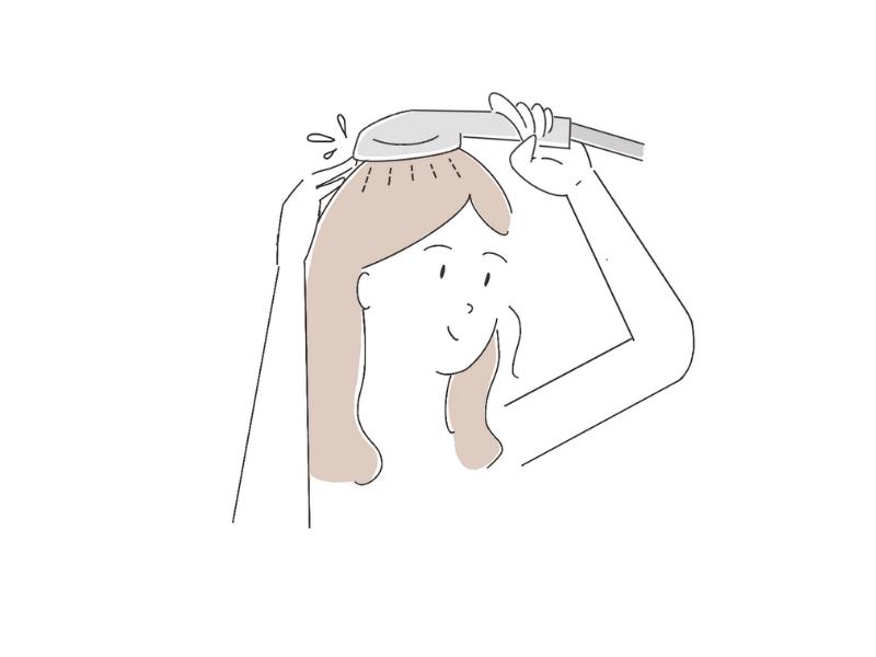 シャワーヘッドを頭皮に当てるイラスト